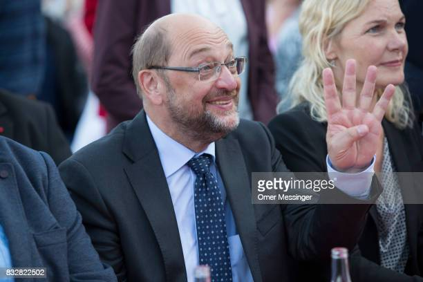 Martin Schulz chancellor candidate of the German Social Democrats is seen gesturing during an election campaign stop on August 16 2017 in Stralsund...