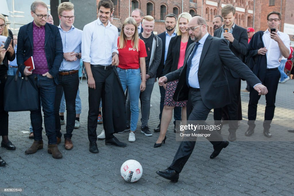 Martin Schulz, chancellor candidate of the German Social Democrats (SPD), is seen kicking a football during an election campaign stop on August 16, 2017 in Stralsund, Germany. Germany is scheduled to hold federal elections on September 24 and Schulz is currently approximately 14 points behind his rival, German Christian Democrat (CDU) and current German Chancellor Angela Merkel, who is seeking a fourth term as chancellor.