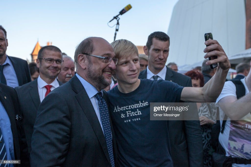 Martin Schulz, chancellor candidate of the German Social Democrats (SPD), Is seen taking a 'Selfie' with a supporter during an election campaign stop on August 16, 2017 in Stralsund, Germany. Germany is scheduled to hold federal elections on September 24 and Schulz is currently approximately 14 points behind his rival, German Christian Democrat (CDU) and current German Chancellor Angela Merkel, who is seeking a fourth term as chancellor.