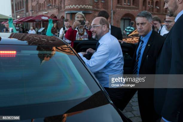 Martin Schulz chancellor candidate of the German Social Democrats is seen entering a car after an election campaign stop on August 16 2017 in...