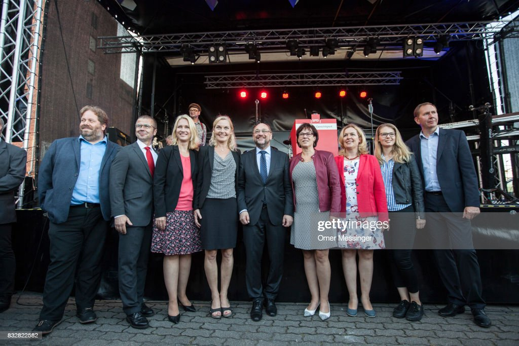 Martin Schulz, chancellor candidate of the German Social Democrats (SPD) (C), is seen posing for a photo with other SPD party members, among them Governor of Mecklenburg-Western Pomerania Manuela Schwesig (3rd left) and Sonja Steffen (4th left) during an election campaign stop on August 16, 2017 in Stralsund, Germany. Germany is scheduled to hold federal elections on September 24 and Schulz is currently approximately 14 points behind his rival, German Christian Democrat (CDU) and current German Chancellor Angela Merkel, who is seeking a fourth term as chancellor.