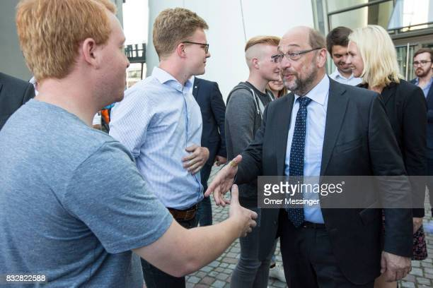Martin Schulz chancellor candidate of the German Social Democrats is seen greeting a supporter as he exits the Ozeanum in the German city of...