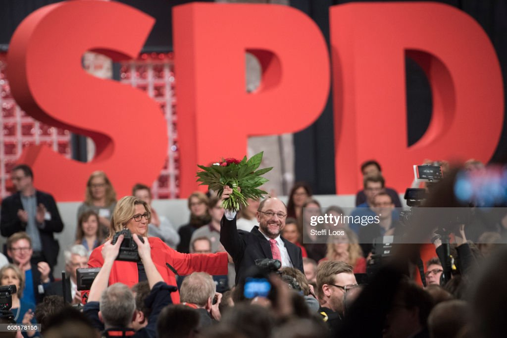 Martin Schulz, chancellor candidate of the German Social Democrats (SPD) holds flowers after beeing nominated and elected as party leader at a Federal Party Congress on March 19, 2017 in Berlin, Germany. Schulz, who announced his candidacy in January has since seen strong support in recent polls and will be officially nominated at the congress. Germany is scheduled to hold federal elections in September.