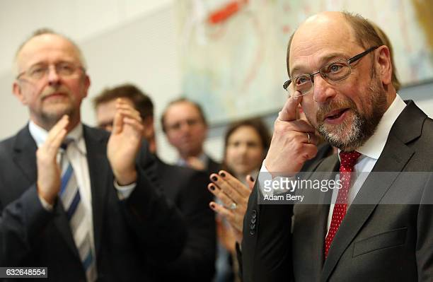 Martin Schulz German Social Democrat politician is applauded as he arrives for a meeting of the party's Bundestag representation on January 25 2017...