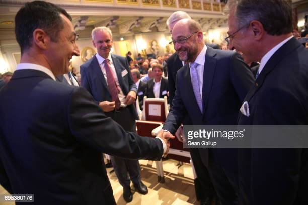 Martin Schulz head of the German Social Democrats and SPD chancellor candidate in German federal elections scheduled for September shakes hands with...