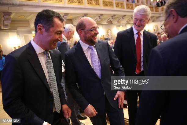 Martin Schulz head of the German Social Democrats and SPD chancellor candidate in German federal elections scheduled for September chats with Cem...
