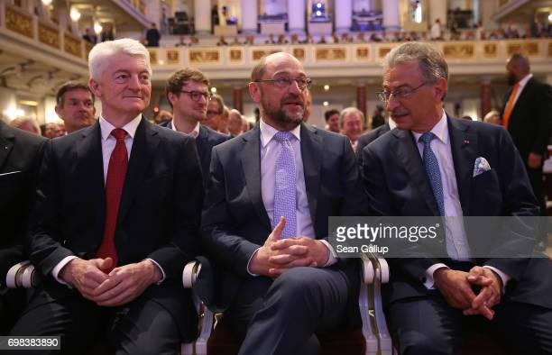 Martin Schulz head of the German Social Democrats and SPD chancellor candidate in German federal elections scheduled for September sits next to BDI...