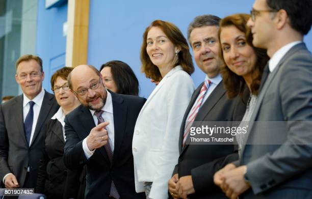 Martin Schulz head of the German Social Democrats and SPD chancellor candidate is flanked by leading members of his party as they arrive at a SPD...