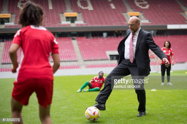 Martin Schulz leader of Germany's social democratic SPD party and candidate for Chancellor plays football with young members of the women's team of...