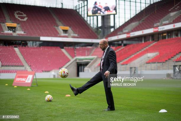 Martin Schulz leader of Germany's social democratic SPD party and candidate for Chancellor plays football as he visits young members of the women's...