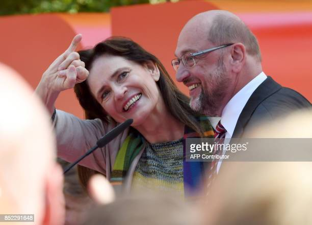 Martin Schulz leader of Germany's social democratic SPD party and candidate for Chancellor stands next to his wife Inge Schulz during an electoral...