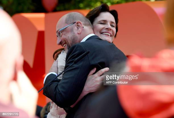 Martin Schulz leader of Germany's social democratic SPD party and candidate for Chancellor hugs his wife Inge Schulz during an electoral meeting on...