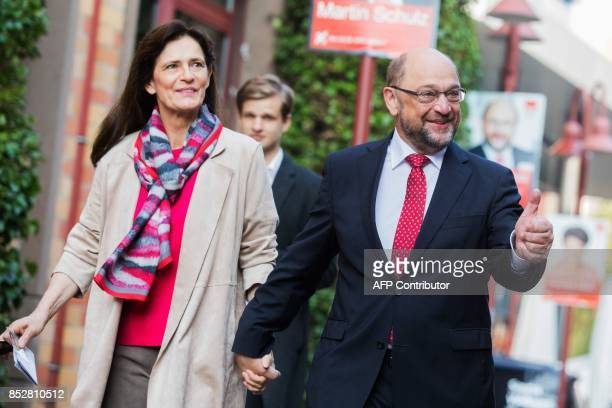 Martin Schulz leader of Germany's social democratic SPD party and candidate for Chancellor and his wife Inge Schulz arrive to cast their ballots at a...