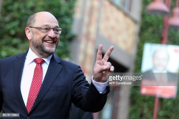 Martin Schulz leader of Germany's social democratic SPD party and candidate for Chancellor makes the victory sign as he arrives to cast his ballot at...