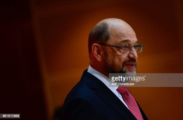 Martin Schulz leader of Germany's social democratic SPD party stands in front of a statue of former SPD leader Willy Brandt as he gives a press...