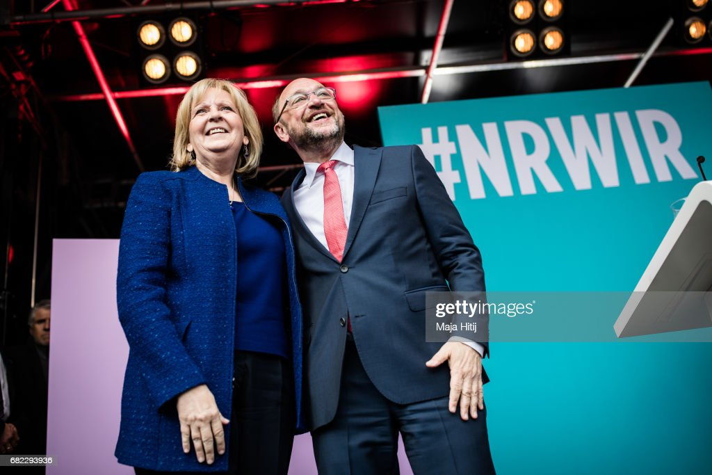 Martin Schulz, leader of the German Social Democrats (SPD), and SPD lead candidate Hannelore Kraft greet supporters at the final SPD campaign rally in state elections in North Rhine-Westphalia on May 12, 2017 in Duisburg, Germany. The North Rhine-Westphalia election will be the third state election in Germany this year and the last before federal elections scheduled for September. The SPD came in second in the last two elections in Saarland and Schleswig-Holstein behind the German Christian Democrats (CDU), a result that is raising the stakes for the SPD and Schulz, who is also the SPD chancellor candidate, for the election in North Rhine-Westphalia, which takes place May 14.