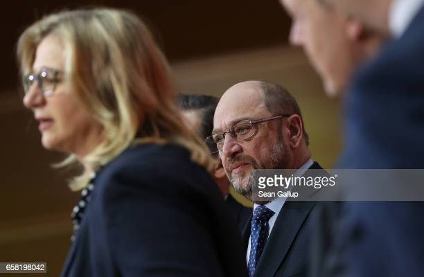 Martin Schulz newlyelected chairman and chancellor candidate of the German Social Democrats looks on as Anke Rehlinger SPD lead candidate in Saarland...