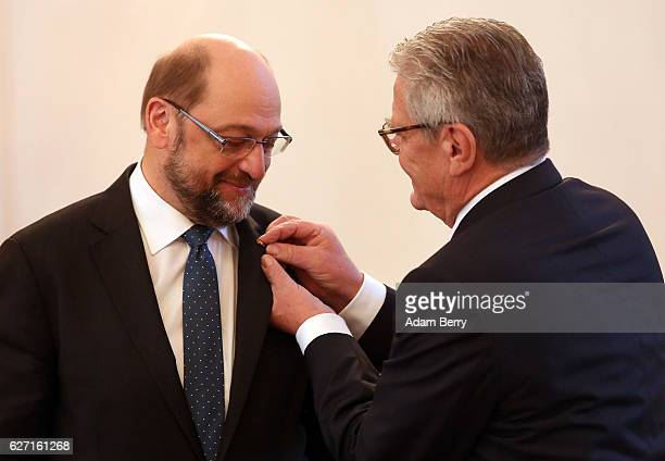 Martin Schulz president of the European Parliament receives the Great Cross of Merit from German President Joachim Gauck on December 2 2016 in Berlin...