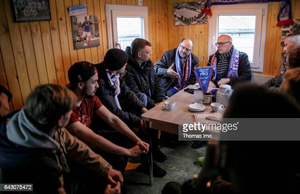 Martin Schulz the chancellor candidate of the German Social Democrats talks to representatives of a AWO fan project on February 19 in a trailer in...