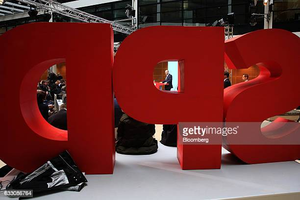 Martin Schulz the Social Democrat Party candidate for German Chancellor center is seen through the SPD logo while speaking during a news conference...
