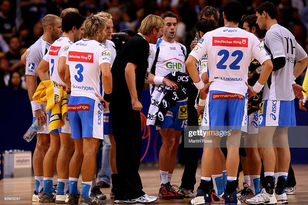 Martin Schwalb (C), head coach of Hamburg argues with his team during the Bundesliga match between HSV Hamburg and SC Magdeburg at the Color Line Arena on September 20, 2008 in Hamburg, Germany.