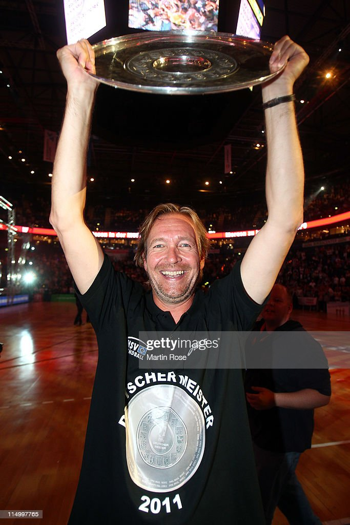Martin Schwalb head coach of Hamburg lifts the trophy after the Toyota Handball Bundesliga match between HSV Hamburg and TBV Lemgo at the o2 World...