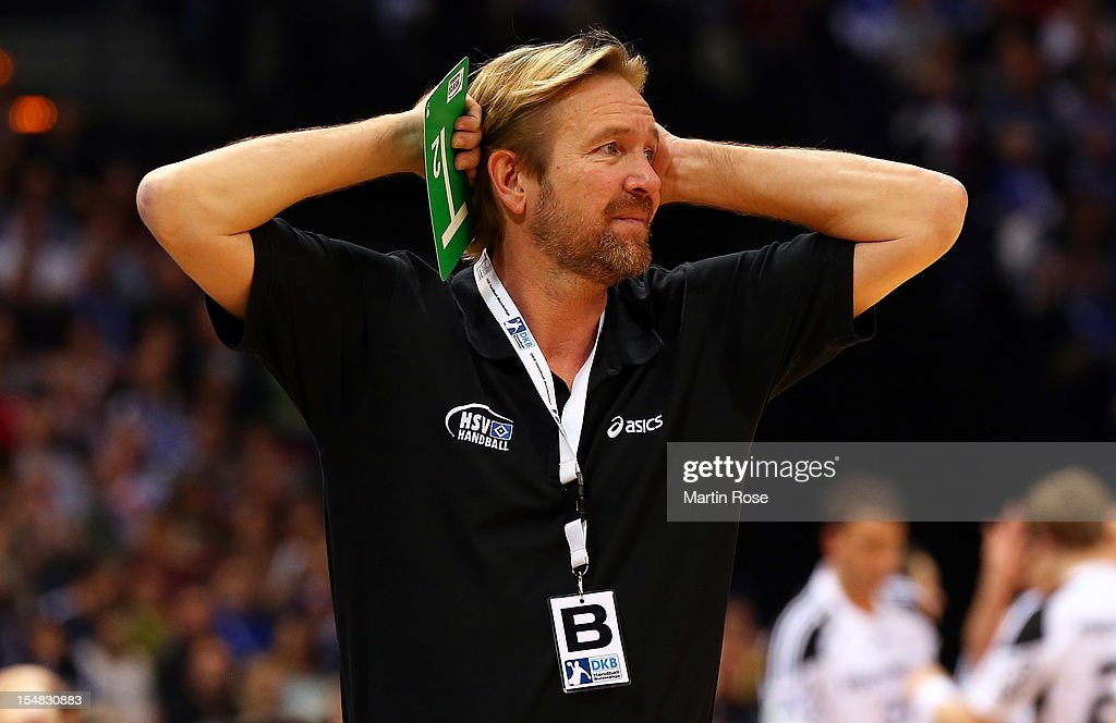 <a gi-track='captionPersonalityLinkClicked' href=/galleries/search?phrase=Martin+Schwalb&family=editorial&specificpeople=607901 ng-click='$event.stopPropagation()'>Martin Schwalb</a> (R), head coach of Hamburg reacts during the DKB Handball Bundesliga match between HSV Hamburg and THW Kiel at the O2 World on October 27, 2012 in Hamburg, Germany.