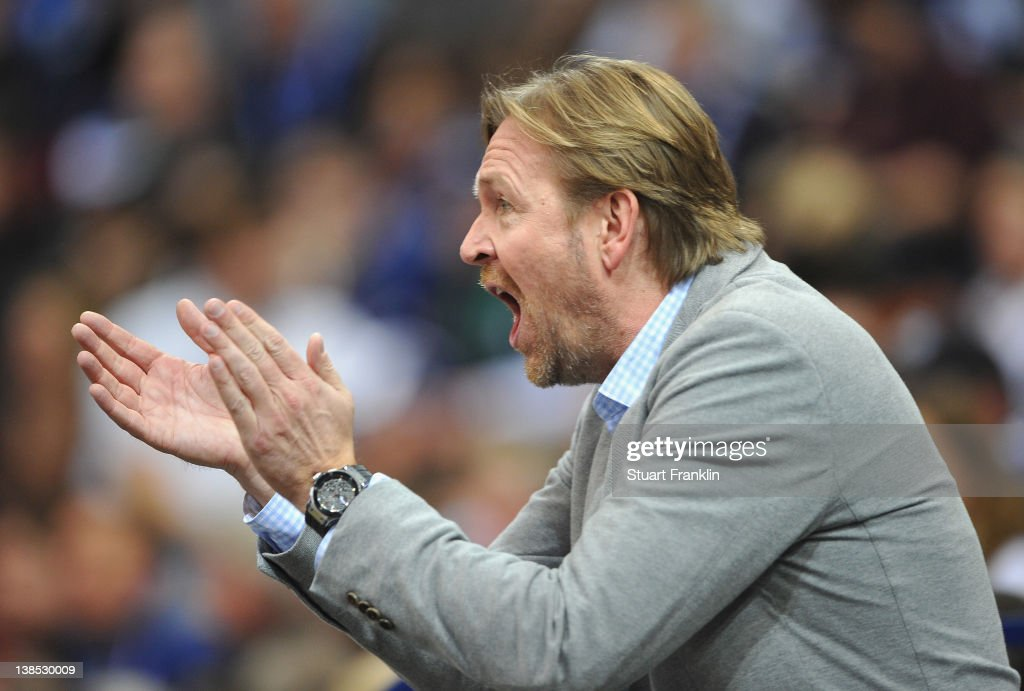 Martin Schwalb president of Hamburg encourages his team during the Toyota Bundesliga handball game between HSV Hamburg and Fuechse Berlin at the O2...