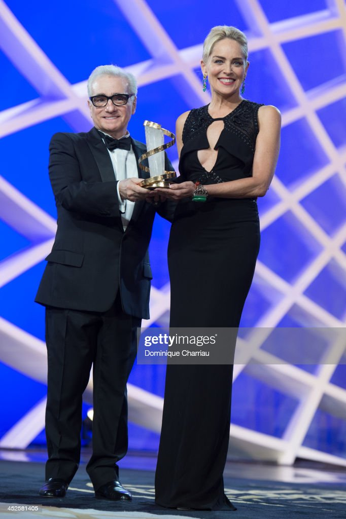 <a gi-track='captionPersonalityLinkClicked' href=/galleries/search?phrase=Martin+Scorsese&family=editorial&specificpeople=201976 ng-click='$event.stopPropagation()'>Martin Scorsese</a> gives an award to <a gi-track='captionPersonalityLinkClicked' href=/galleries/search?phrase=Sharon+Stone&family=editorial&specificpeople=156409 ng-click='$event.stopPropagation()'>Sharon Stone</a> during the opening ceremony of the 13th Marrakesh International Film Festival on November 29, 2013 in Marrakech, Morocco.