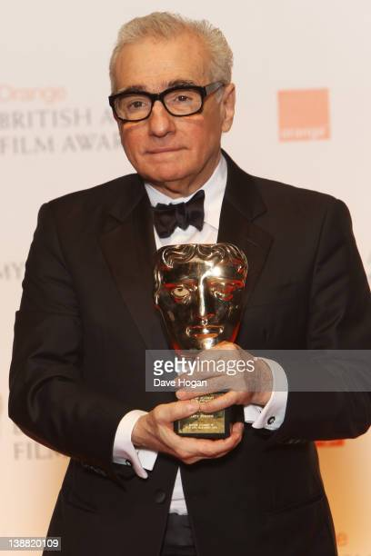 Martin Scorsese poses with his Fellowship Award in the press room at The Orange British Academy Film Awards 2012 at The Royal Opera House on February...