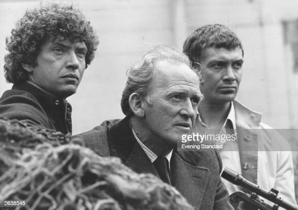 Martin Shaw playing Doyle Gordon Jackson playing Cowley and Lewis Collins playing Bodie testing the 180 laser beam gun from episode one of The...