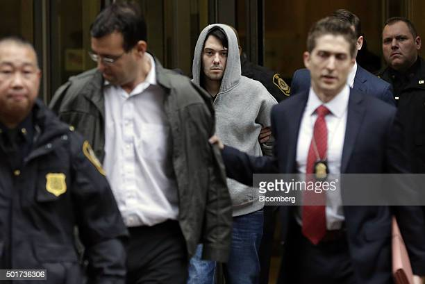 Martin Shkreli chief executive officer of Turing Pharmaceuticals LLC center and attorney Evan Greebel left exit federal court in New York US on...