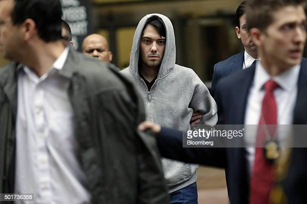 Martin Shkreli chief executive officer of Turing Pharmaceuticals LLC center exits federal court in New York US on Thursday Dec 17 2015 Shkreli was...