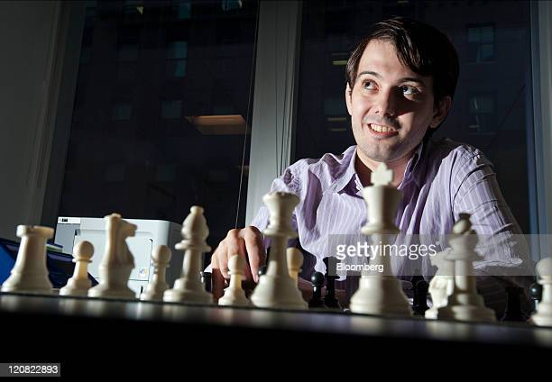 Martin Shkreli chief investment officer of MSMB Capital Management sits behind a chess board in New York US on Wednesday Aug 10 2011 MSMB made an...