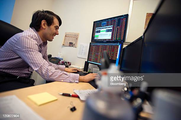 Martin Shkreli chief investment officer of MSMB Capital Management works on a computer in his office in New York US on Wednesday Aug 10 2011 MSMB...