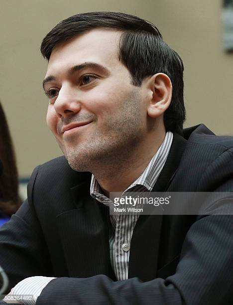 Martin Shkreli former CEO of Turing Pharmaceuticals smiles during a House Oversight and Government Reform Committee hearing on Capitol Hill February...