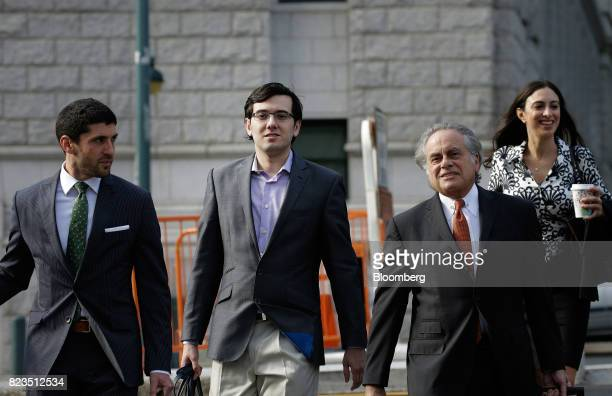 Martin Shkreli former chief executive officer of Turing Pharmaceuticals AG center left arrives at federal court with his attorney Benjamin Brafman...