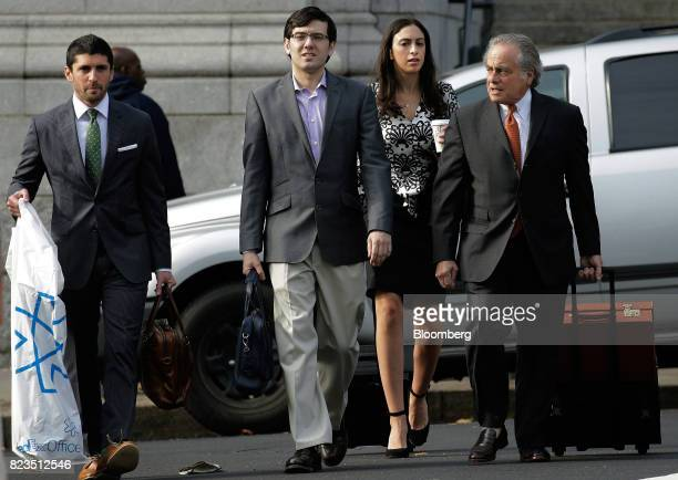 Martin Shkreli former chief executive officer of Turing Pharmaceuticals AG center arrives at federal court with his attorney Benjamin Brafman right...
