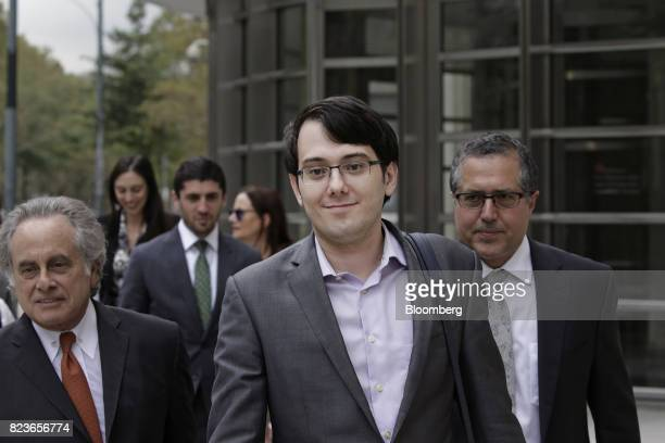 Martin Shkreli former chief executive officer of Turing Pharmaceuticals AG center exits federal court with his attorney Benjamin Brafman left in the...