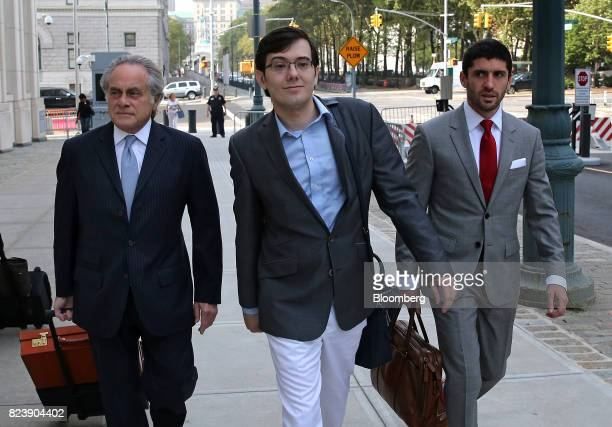 Martin Shkreli former chief executive officer of Turing Pharmaceuticals AG center arrives at federal court with his attorney Benjamin Brafman left in...