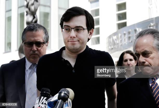 Martin Shkreli former chief executive officer of Turing Pharmaceuticals AG center pauses while speak to members of the media with his attorney...