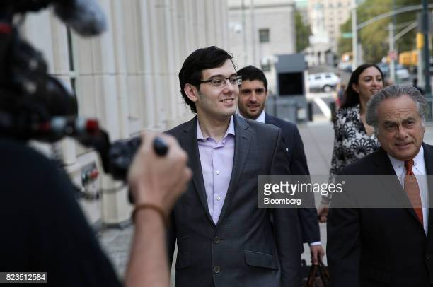 Martin Shkreli former chief executive officer of Turing Pharmaceuticals AG left arrives at federal court with his attorney Benjamin Brafman right in...