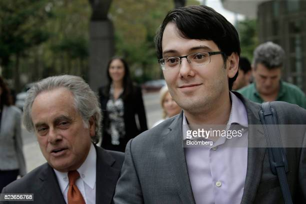 Martin Shkreli former chief executive officer of Turing Pharmaceuticals AG right exits federal court with his attorney Benjamin Brafman in the...