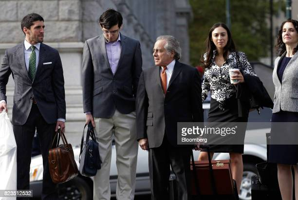 Martin Shkreli former chief executive officer of Turing Pharmaceuticals AG second left arrives at federal court with his attorney Benjamin Brafman...