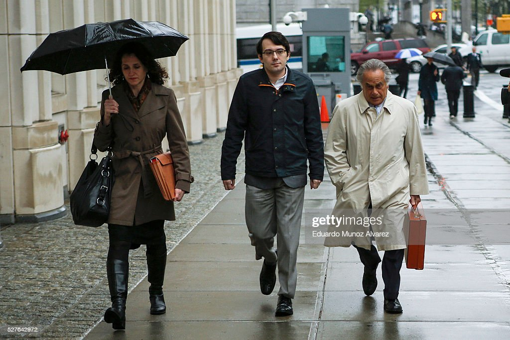 <a gi-track='captionPersonalityLinkClicked' href=/galleries/search?phrase=Martin+Shkreli&family=editorial&specificpeople=8043643 ng-click='$event.stopPropagation()'>Martin Shkreli</a>, (C) former Chief Executive Officer of Turing Pharmaceuticals LLC, arrives to federal court with his attorney <a gi-track='captionPersonalityLinkClicked' href=/galleries/search?phrase=Benjamin+Brafman&family=editorial&specificpeople=2776479 ng-click='$event.stopPropagation()'>Benjamin Brafman</a>, (R) on May 3, 2016 in the Brooklyn borough of New York City. Shkreli appears in U.S. District Court to face multiple fraud charges, including illegally siphoning money from one of his companies to pay off bad market bets made by another of his companies.