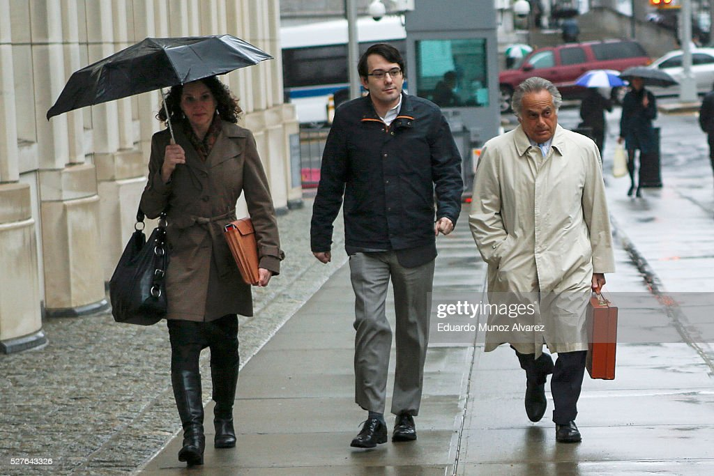 Martin Shkreli, (C) former Chief Executive Officer of Turing Pharmaceuticals LLC, arrives to federal court with his attorney Benjamin Brafman, (R) on May 3, 2016 in the Brooklyn borough of New York City. Shkreli appears in U.S. District Court to face multiple fraud charges, including illegally siphoning money from one of his companies to pay off bad market bets made by another of his companies.