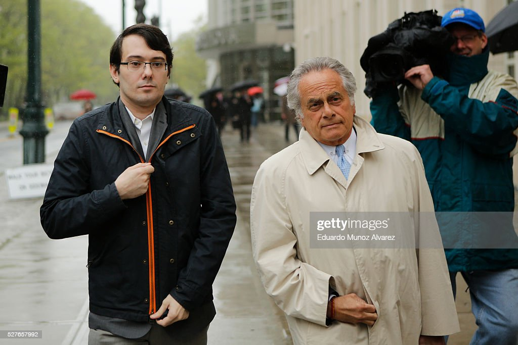 <a gi-track='captionPersonalityLinkClicked' href=/galleries/search?phrase=Martin+Shkreli&family=editorial&specificpeople=8043643 ng-click='$event.stopPropagation()'>Martin Shkreli</a>, (L) former Chief Executive Officer of Turing Pharmaceuticals LLC, exits federal court with his attorney <a gi-track='captionPersonalityLinkClicked' href=/galleries/search?phrase=Benjamin+Brafman&family=editorial&specificpeople=2776479 ng-click='$event.stopPropagation()'>Benjamin Brafman</a>, on May 3, 2016 in the Brooklyn borough of New York City. Shkreli appeared in U.S. District Court to face multiple fraud charges, including illegally siphoning money from one of his companies to pay off bad market bets made by another of his companies.