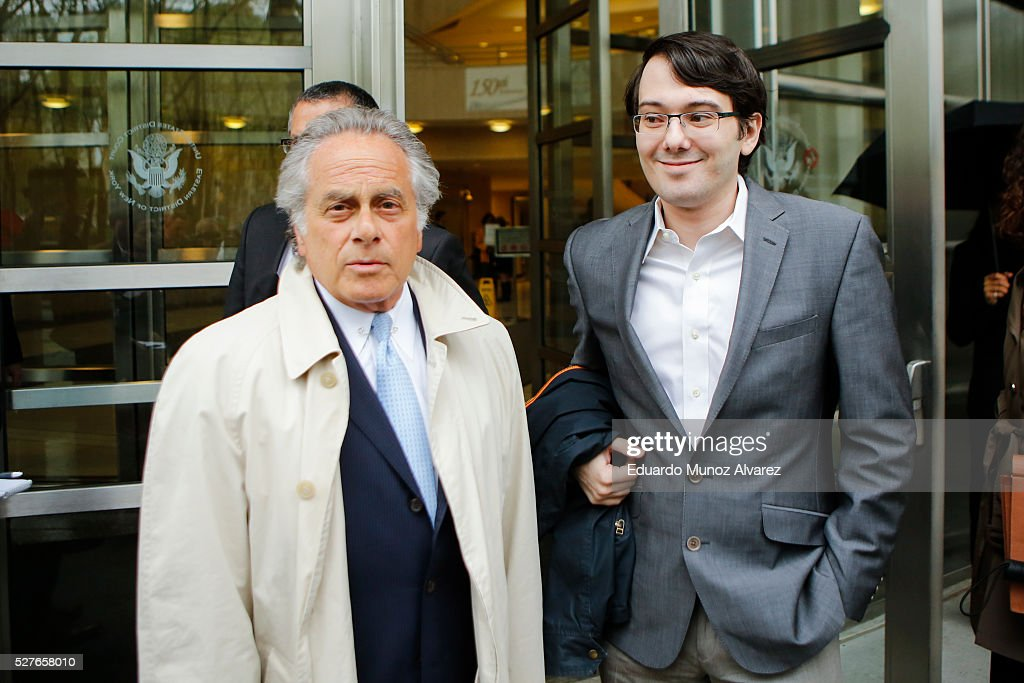 Martin Shkreli, (R) former Chief Executive Officer of Turing Pharmaceuticals LLC, exits federal court with his attorney Benjamin Brafman, on May 3, 2016 in the Brooklyn borough of New York City. Shkreli appeared in U.S. District Court to face multiple fraud charges, including illegally siphoning money from one of his companies to pay off bad market bets made by another of his companies.