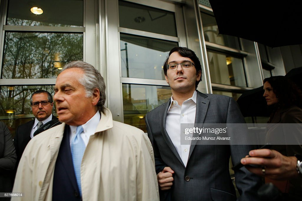 <a gi-track='captionPersonalityLinkClicked' href=/galleries/search?phrase=Martin+Shkreli&family=editorial&specificpeople=8043643 ng-click='$event.stopPropagation()'>Martin Shkreli</a>, (R) former Chief Executive Officer of Turing Pharmaceuticals LLC, exits federal court with his attorney <a gi-track='captionPersonalityLinkClicked' href=/galleries/search?phrase=Benjamin+Brafman&family=editorial&specificpeople=2776479 ng-click='$event.stopPropagation()'>Benjamin Brafman</a>, on May 3, 2016 in the Brooklyn borough of New York City. Shkreli appeared in U.S. District Court to face multiple fraud charges, including illegally siphoning money from one of his companies to pay off bad market bets made by another of his companies.