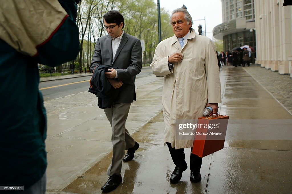 Martin Shkreli, (L) former Chief Executive Officer of Turing Pharmaceuticals LLC, exits federal court with his attorney Benjamin Brafman, on May 3, 2016 in the Brooklyn borough of New York City. Shkreli appeared in U.S. District Court to face multiple fraud charges, including illegally siphoning money from one of his companies to pay off bad market bets made by another of his companies.